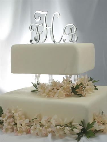 acrylic mirror monogram wedding cake topper with silver reflective finish to give the appearance of a